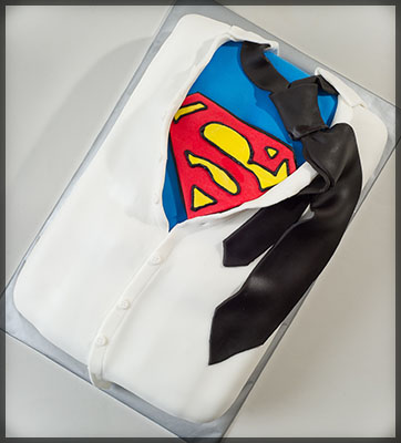 https://www.cremedelacakes.ca - Superman Revealed